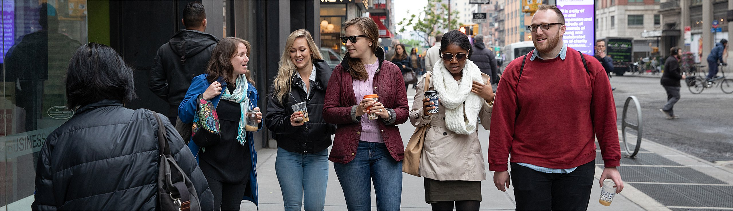 The On-Ramps team walks down a busy NYC street after a coffee break